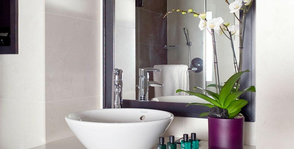 Un baño con todas las comodidades que usted necesita