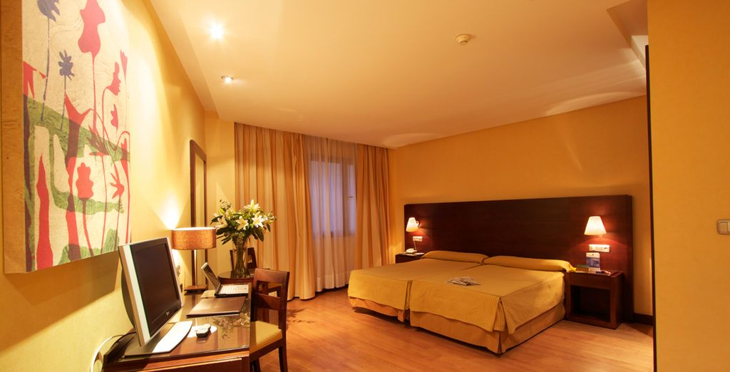 Descansa en tu amplia y confortable habitación