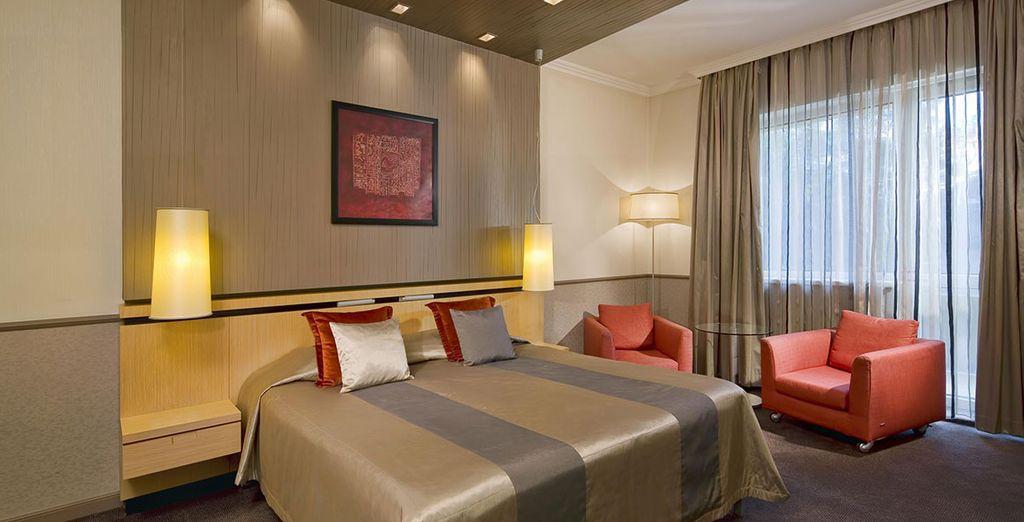 Descansa en tu habitación Deluxe con balcón
