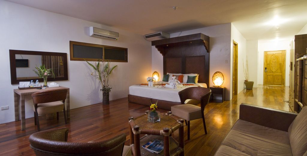 Descanse en una confortable Habitación Deluxe
