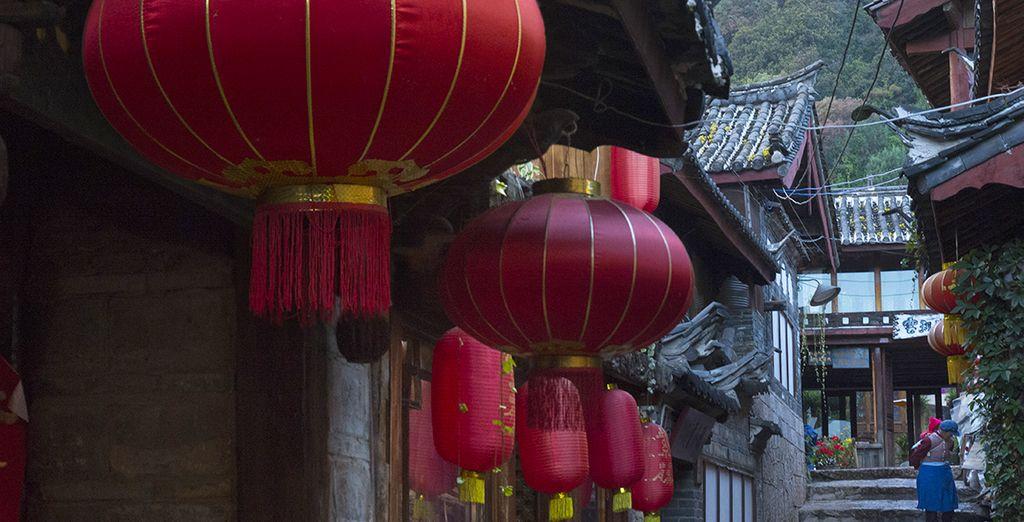 Qui vous mènera à travers la vieille ville de Lijiang