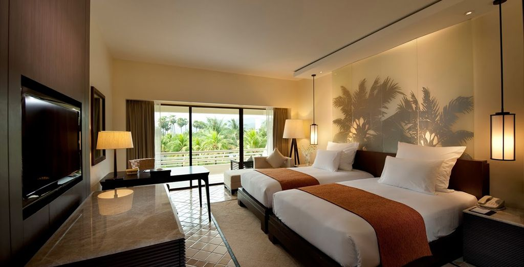 Vous y séjournerez en chambre Deluxe Vue Jardin, spacieuse et moderne