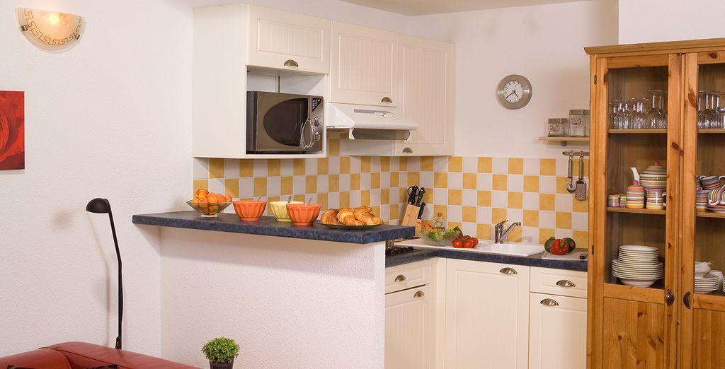 Préparez de délicieux petits plats dans votre cuisine équipée...