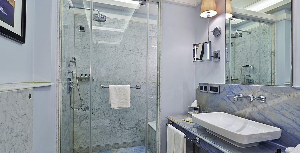 And enjoy the beautiful Carrara marble bathroom