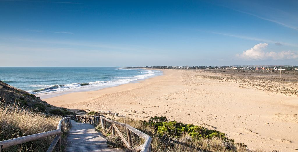 Just steps away from the warm, golden sands and Atlantic Ocean...