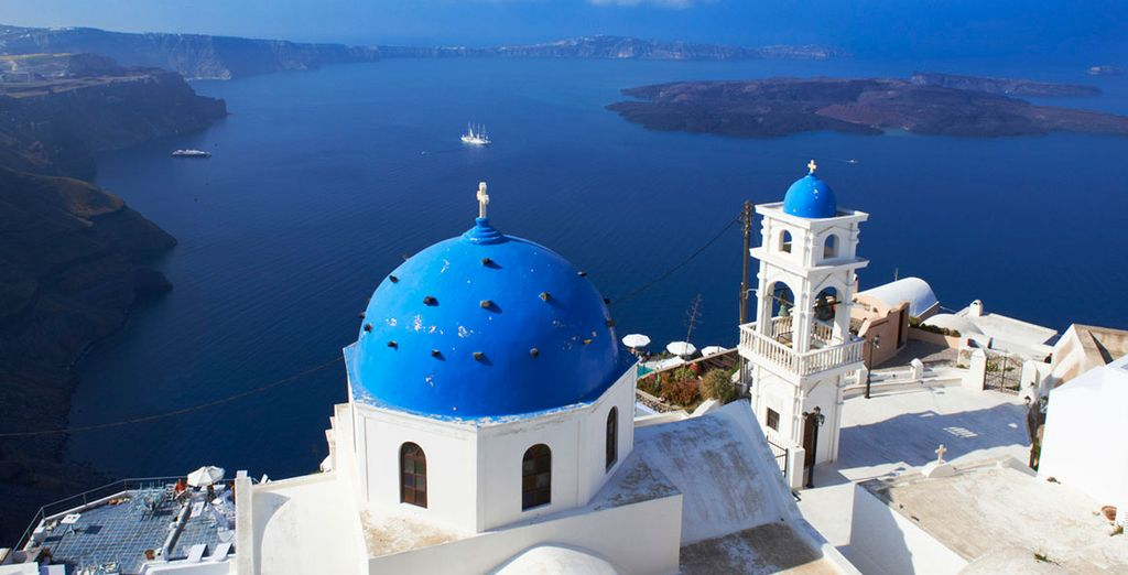 Take a private boat trip to the islands of Santorini and Mykonos