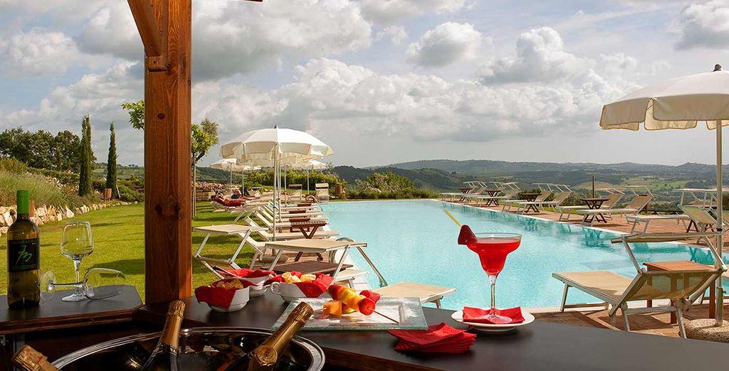 Soak up the sunshine with a cocktail - Saturnia Tuscany Hotel 4* Tuscany