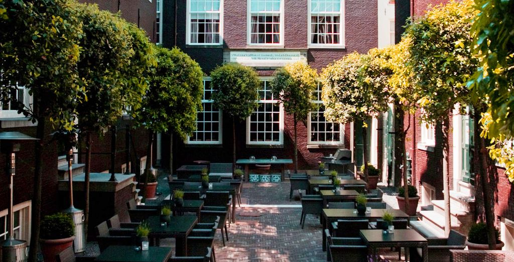 After sightseeing, enjoy a glass of wine in the pretty courtyard