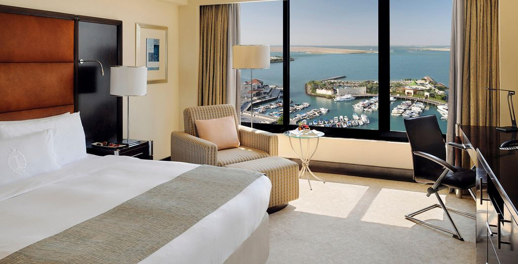 From your upgraded Deluxe Sea View Room