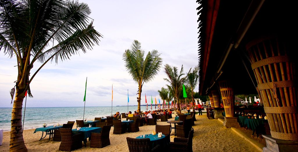 Tuck into meals on the golden sands