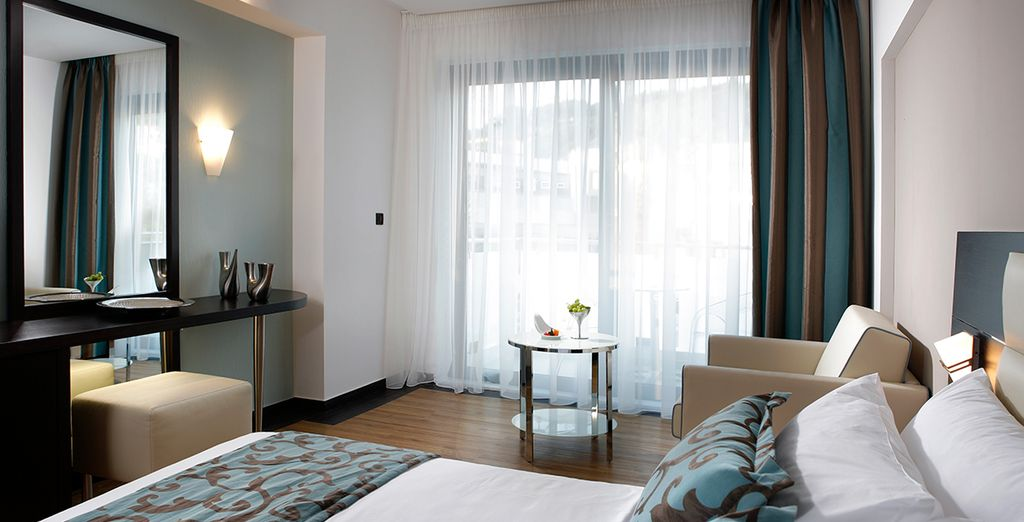 Stay in a Deluxe Double Room complete with a balcony or terrace