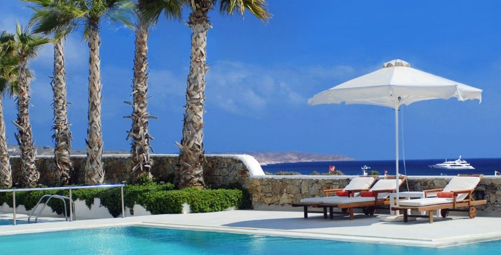 Or cool down in the outdoor pool under the glistening sun