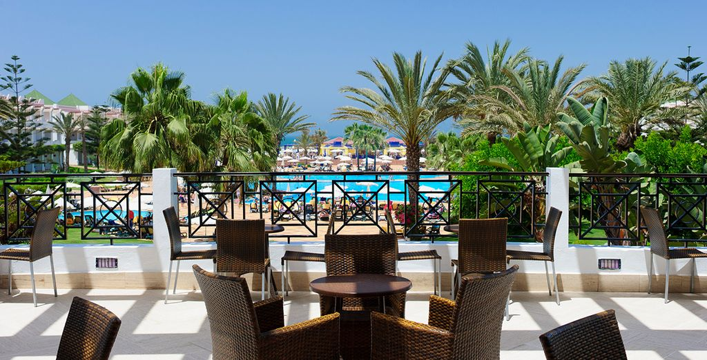 Laze by the pool with a cool drink or take a snack al-fresco