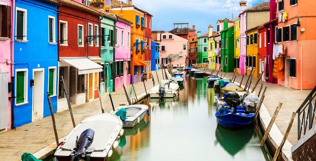 Cruise alongside the colourful houses of Burano...