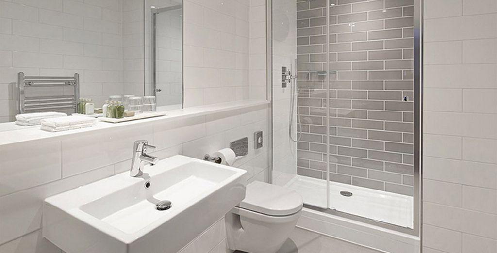 Which features a sleek designer bathroom