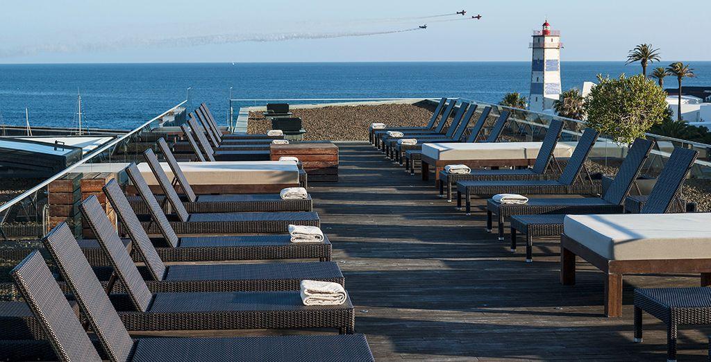 Sunbathe on the terrace overlooking the coast