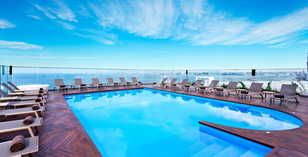 Head up to the rooftop pool with magnificent views towards the sea