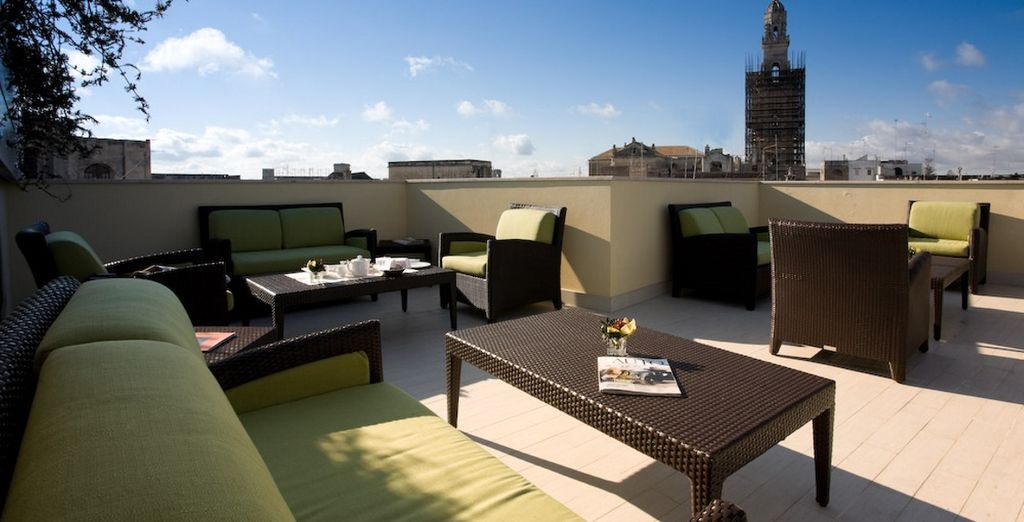 Relax with a drink on the rooftop after sightseeing