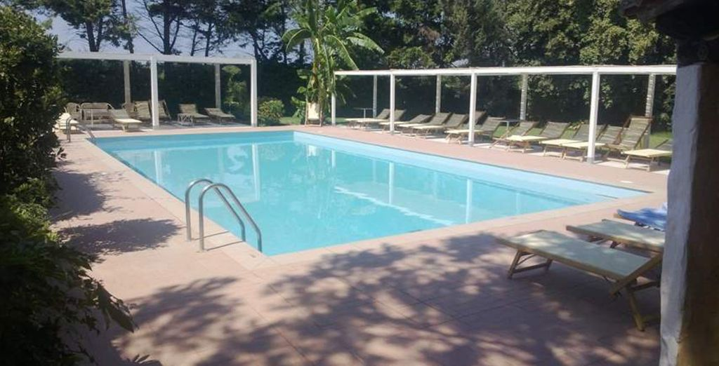 Sunbathe by the swimming pool
