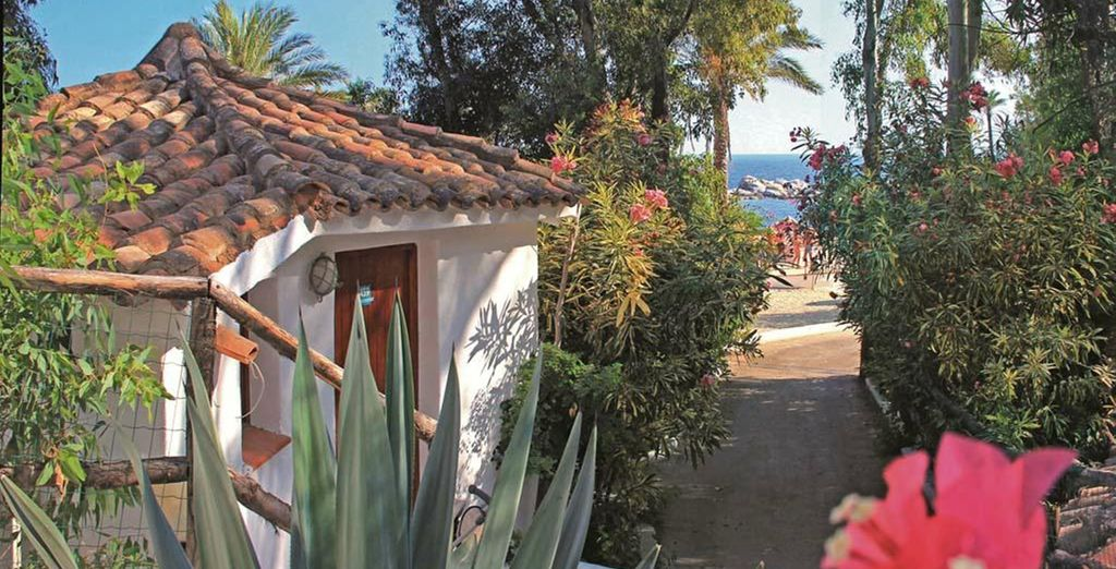 Charming cottages set along rustic pathways - a moment's walk from the sea