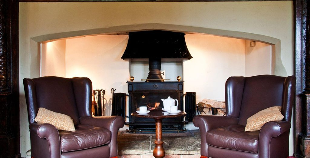 Cosy up by the warm fireplace