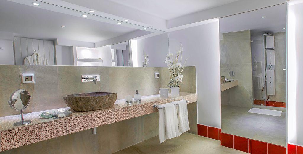 With an expansive, sleek bathroom