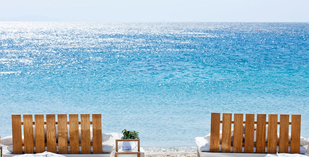 Set on Ornos beach, you are just steps from the sandy shore...