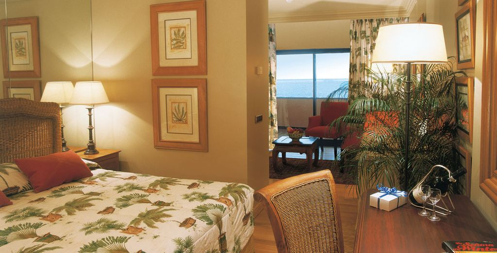Enjoy an upgrade to a spacious Junior Suite with an ocean view