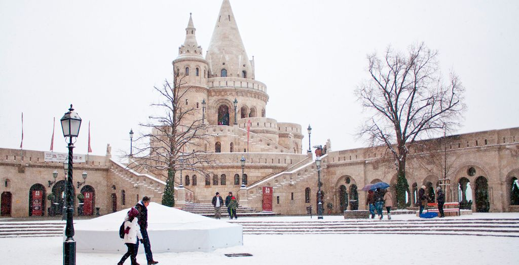 Discover its landmarks dusted with white snow