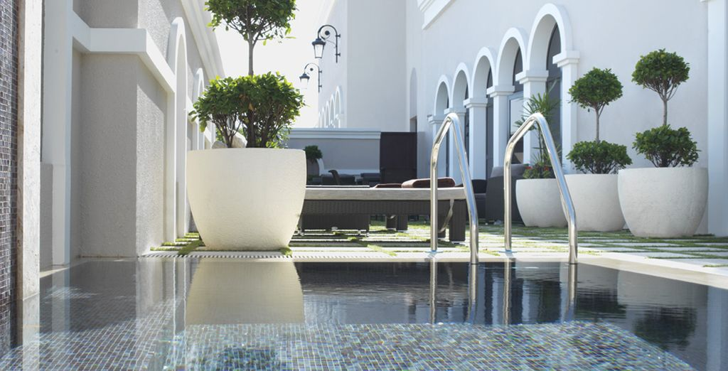 Recline in the secluded outdoor spa terrace