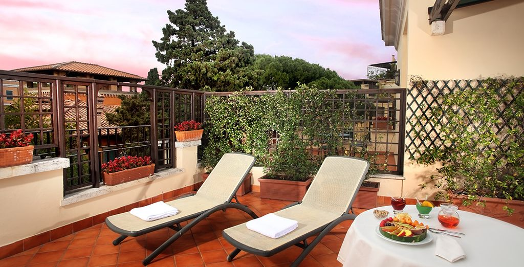Or enjoy an aperitif on the roof with views of Rome