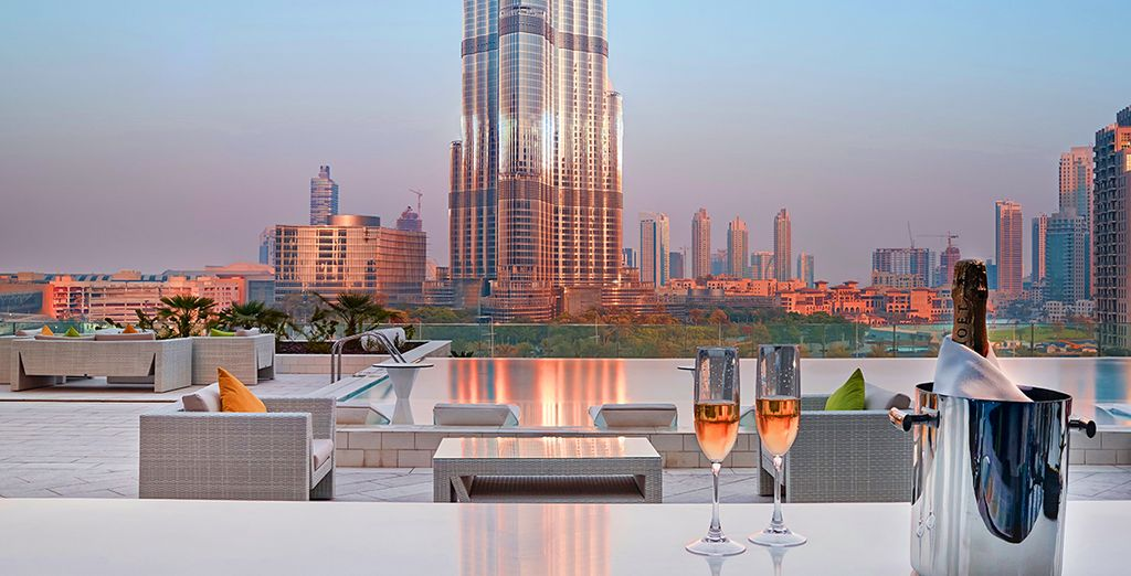 Sip champagne from the rooftop lounge as you watch the sunset over the city...