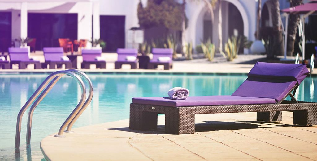 In the warmer months, soak up the sunshine by the pool