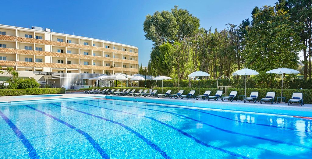 Relax by the sparkling outdoor pool in the summer months