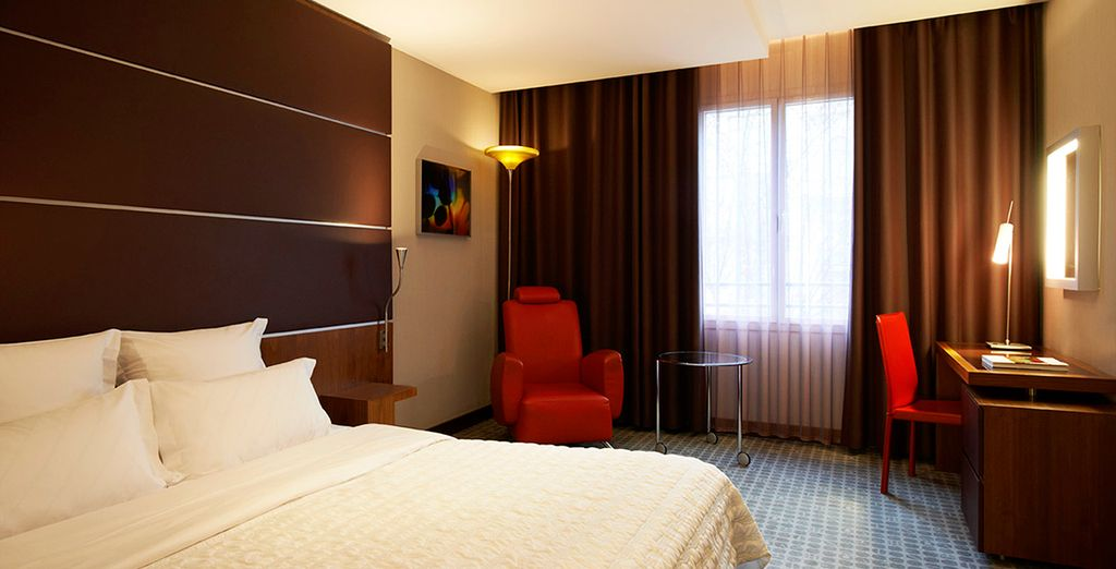 Stay in a spacious Deluxe Room