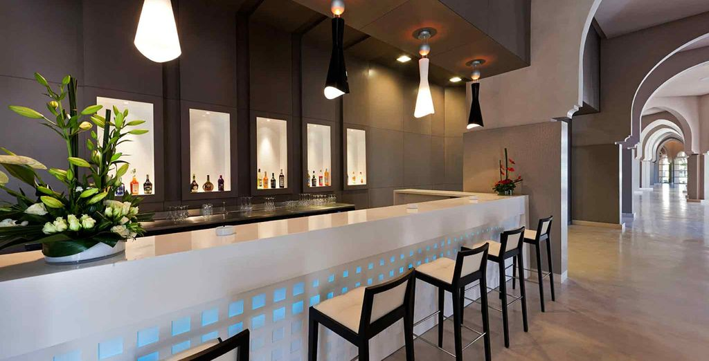Return to your hotel for an expertly mixed cocktail at the sleek bar