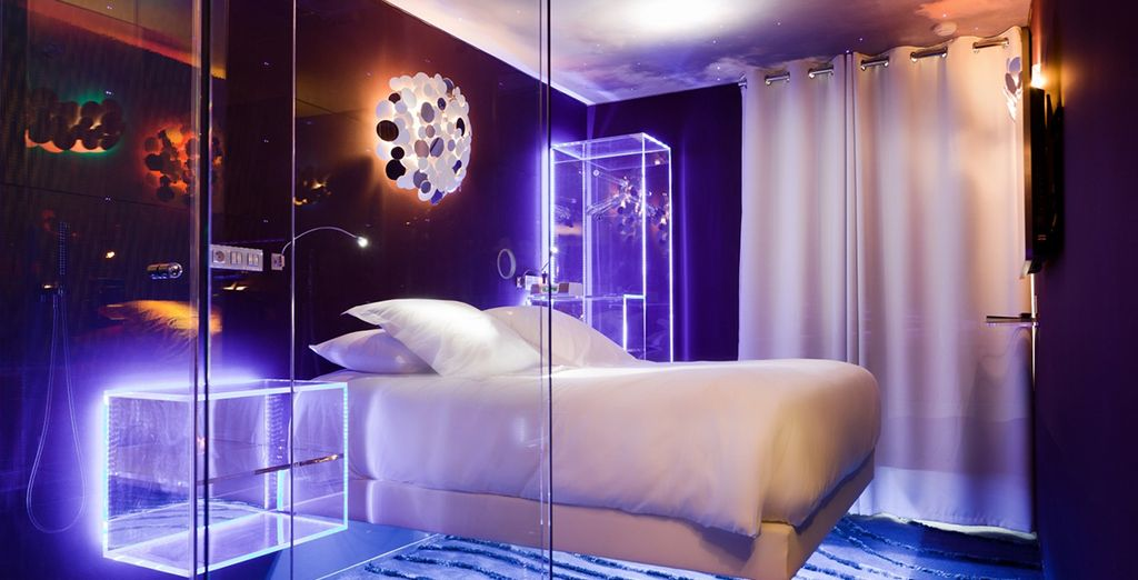 A levitating bed is just one of the quirky design features of this striking hotel! - Hotel Seven 4* Paris