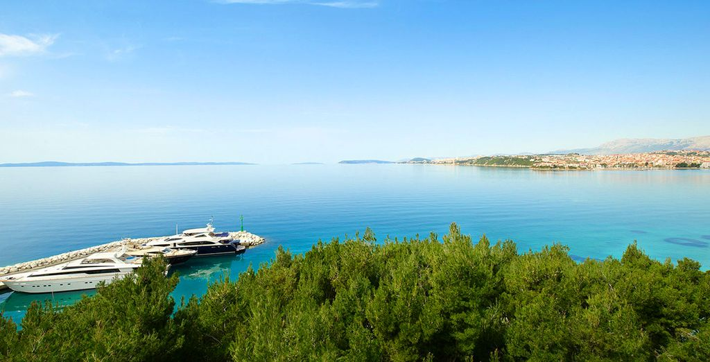 The stunning blue waters and the light, verdant coastline make for awe-inspiring vistas