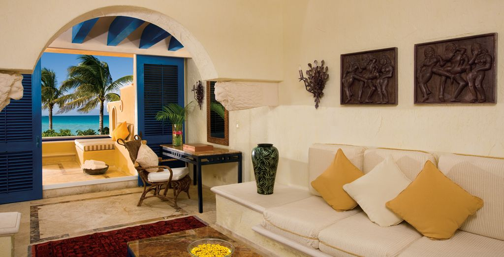 Stay in an elegant Ocean Front 1 Bedroom Suite with Plunge Pool