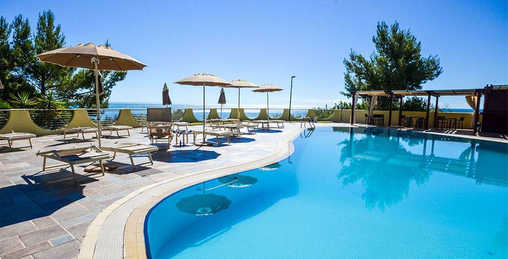 Book a stay at the 5* Baia dei Faraglioni Beach Resort