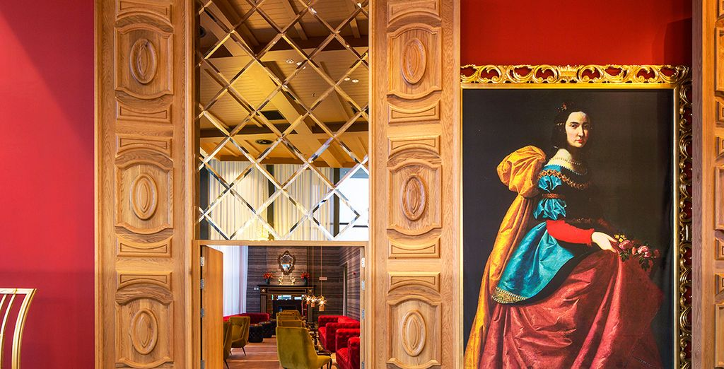 Explore the hotel's grand halls, lined with art