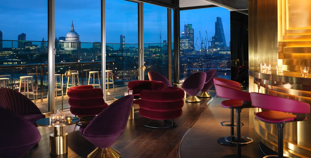 End your day at the cocktail bar with spectacular city views