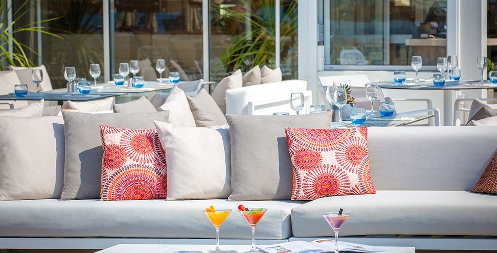 Chill out with a cocktail at the stylish beach bar