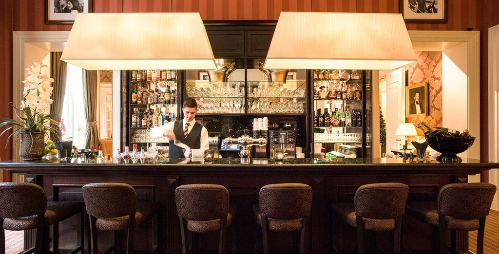 Enjoy a drink at the well-stocked bar