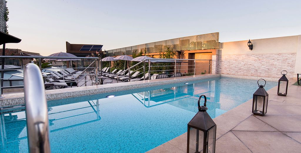 Refresh with a dip in the rooftop pool on your return...