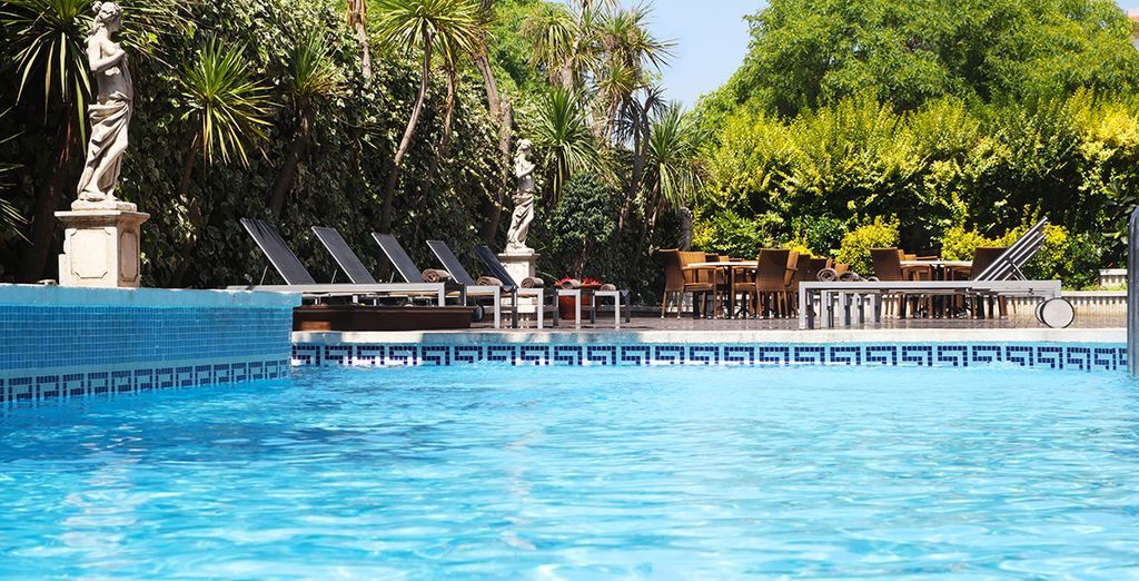 Relax by the outdoor pool in the summer months...