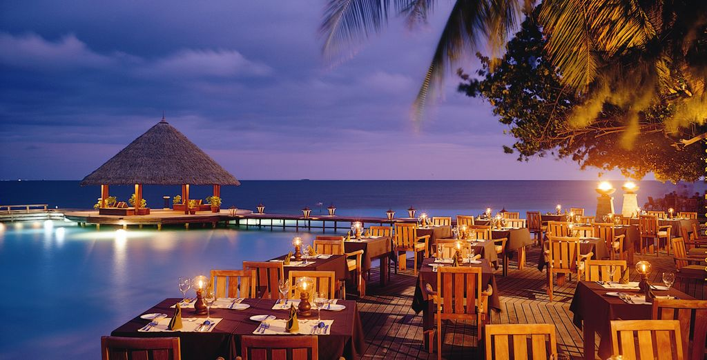 Come evening, dine by candlelight overlooking the Indian Ocean