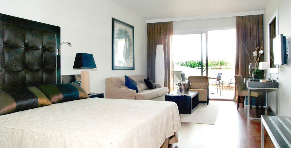 Enjoy a Deluxe Room with daily breakfast included