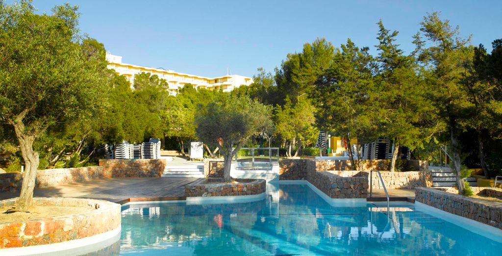 Soak up the sunshine by the swimming pool...