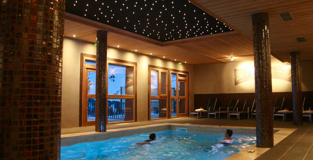 After a day on the slopes, enjoy a refreshing dip in the ethereal indoor pool